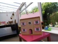 Simplw wooden doll's house and furniture