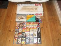COMMODORE 64 COMPUTER WITH DATASETTE, MOUSE, JOYSTICKS, LIGHTGUNS, MANUALS AND GAMES