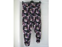 Peacocks Trousers Black with blue, pink & white small flower pattern. Not new, cost £10 size 12