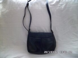 2 ladies strong and sturdy handbags 1 solid stitched all leather, 1 material style
