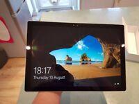 Surface Pro 4, Intel i5, 8GB Ram, 256GB SSD, still under warranty.