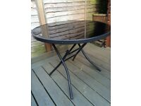 Black glass outdoor table