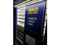 Tobacco stand with sliding doors
