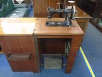 antique afrana treadle powered sewing machine.
