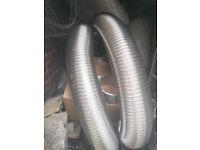 "Chimney liner 904 grade steel 6.5m 7"" diameter plus 1m off-cut, flue jacket insulation, fixings"