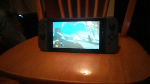 Like-new Nintendo Switch and Zelda For Sale