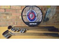 Assorted golf clubs and net