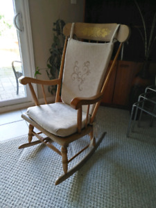 Vintage solid wood rocking chair with new padded cover