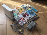 As new Nintendo wii +6 games, 1 remote and 1 nunchuck.