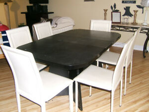 Black Table with Six white leather chairs