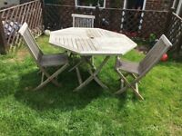 Octagonal table and 3 chairs