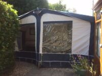 Caravan Awning (850) in blue, hardly used, great condition with zip panels and annexe tent