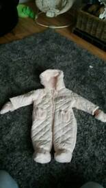 Pink and silver snowsuit
