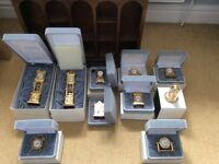 Collection of miniature clocks with display stand