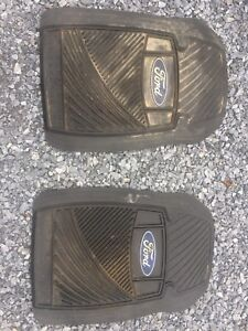 A pair of front Ford floor mats