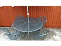 Garden patio table and 4 armchairs with parasol set