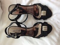 Black zone strapped shoes - new