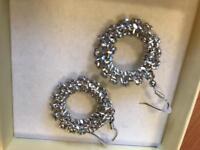 Unused silver earrings