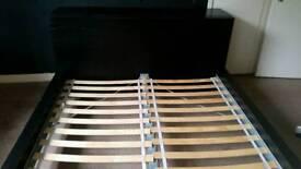 Black Ikea Skorva Bed, Sideboard & roll behind shelves
