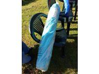 New light blue garden umbrella and three green garden chairs
