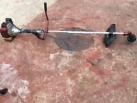 Mitsubishi 200 commercial long reach grass strimmer. Steel blade head included for rough bushes.