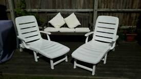 White garden lounger beds