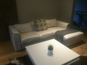 White real leather sectional with white coffee table