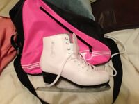 Ladies size 5/6, white ice skates, worn twice comes with case and guards