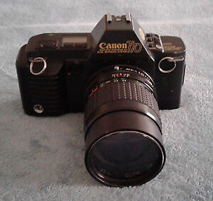 CANON T70 35 MM CAMERA AND LARGE ZOOM LENS
