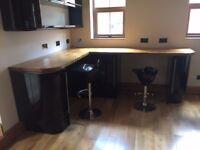 Corner unit, oak worktops, black gloss cupboards
