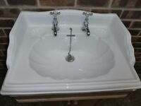 traditional white sink with chrome taps