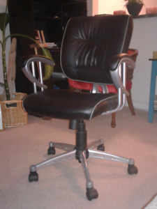 Fully adjustable leather desk chair.