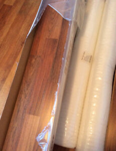4 Boxes 3 unopened laminate floor plus various cuts & 2 rolls