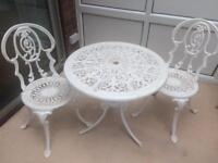 White wrought iron table and 2 chairs