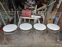 Four stacking chairs chrome frame and wooden seats.