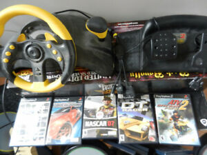 Mad Catz universal wheel with PS2 games and petals XBOX, GC