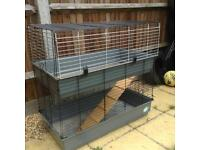 Large two story indoor cage rabbits/Guinea pigs.