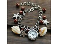 New Ladies brown Shell Charm bracelet Watch.