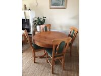 Pine dining table with four pine chairs