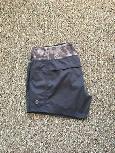 NEW CONDITION LULULEMON LINED SHORTS WITH SNOWY OWL WAIST BAND!