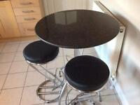 Black granite topped table plus 3 padded bar stools