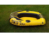 Inflatable boat with paddles hardly used