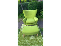 A New Lime Green Upholstered Winged Back Arm Chair and Footstool.