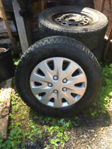 4-Cooper Discover A/T3 Winter tires on Rims. 235 R65 17 5 bolt,