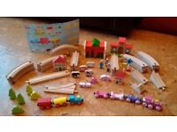 Chad Valley Wooden Train Set with extra train and pieces.
