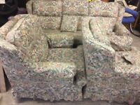 Patterned sofa with matching chairs