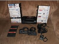 Sega Master System with 26 games, leads, power supply and two controllers.