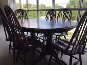 Medium/Dark Oak Dining Table and 11 chairs,