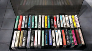40 assorted cassettes in black vinyl case with plastic lid Picku