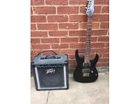 Ibanez electric guitar and peavey amp